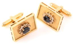 Sale 9149 - Lot 518 - A PAIR OF 18CT GOLD SAPPHIRE AND DIAMOND CUFF LINKS; 21 x 15mm rectangular textured plaque tops each applied with a cluster centring...