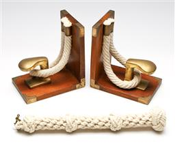 Sale 9253 - Lot 232 - A pair of timber and brass naval themed bookends (H:16.5cm) together with a weaved rope handle with brass connector