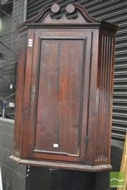 Sale 8291 - Lot 1012 - Late Georgian Mahogany Hanging Corner Cabinet, with swan-neck pediment, crossbanded door & fluted fascia - some faults (key in office).