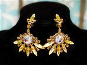 Sale 8577 - Lot 172 - A pair of vintage showgirl amber/ borealis star clip on earrings, Condition: Very Good (reworked)