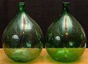 Sale 8984H - Lot 330 - A near pair of green glass wine flasks each height 65cm