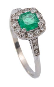 Sale 9012 - Lot 308 - A VINTAGE 18CT GOLD EMERALD AND DIAMOND RING; cushion form cluster centring a square emerald cut emerald of approx. 0.50ct to surrou...