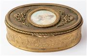 Sale 9083N - Lot 33 - A French gilt bronze hinged trinket box with a painted femail portrait slr. Length 11cm