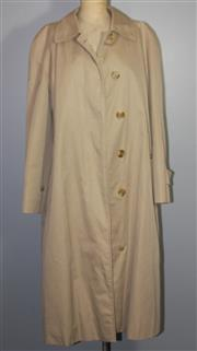 Sale 8087B - Lot 382 - A LADYS BURRBERRYS LONG TRENCH COAT; with classic nova check lining and label made for Harrods, size M
