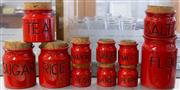 Sale 8310A - Lot 214 - A set of 11 graduated red ceramic kitchen canisters