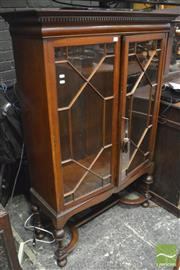 Sale 8359 - Lot 1055 - Early 20th Century Mahogany Book Case with 2 astragal doors turned legs and stretcher base (Key in Office)