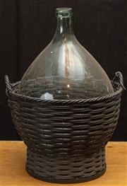 Sale 8984H - Lot 331 - A clear glass wine bottle in wicker basket height 75cm