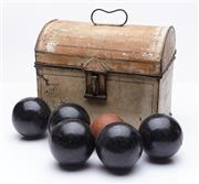 Sale 9080W - Lot 84 - A Victorian wooden bocce set of six balls in a hinged tin casket.