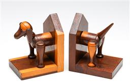Sale 9253 - Lot 234 - A pair of wooden bookends in the form of a toy dog (H:14cm)