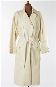 Sale 8550F - Lot 76 - A Chanel, Amen Wardy, poly blend long cream trench coat with gilt Chanel buttons, some wear, size M-L.