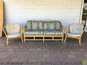 Sale 8649R - Lot 143 - Cane Three Piece Lounge Setting with a 2 Seater Lounge with Twisted Armrests and Two Armchairs