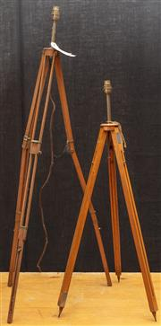 Sale 8984W - Lot 515 - Two timber photographers tripods, both converted to electricity as lamps. Taller height 120cm approx.