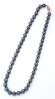 Sale 9029 - Lot 342 - A FRESHWATER BLACK PEARL NECKLACE; 8mm off round cultured pearls to a 9ct white gold ball clasp, length 46cm.