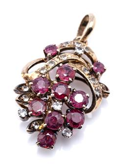 Sale 9194 - Lot 556 - A SILVER GILT RUBY AND STONE SET PENDANT; set with round cut treated rubies and round cut zirconias, size 30 x 18mm, wt. 3.62g.
