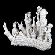 Sale 8000 - Lot 359 - A Chinese blanc de chine figural group depicting a Lohan and attendants including a crane and a deer on a wave base.