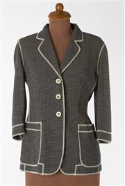 Sale 8550F - Lot 48 - A Moschino 100% virgin wool houndstooth jacket with white stitched trimming, bone buttons, and word stitched to back, size 10.