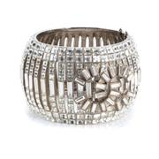 Sale 8857 - Lot 405 - A VINTAGE CHANEL CRYSTAL CUFF BANGLE; 5cm wide Maison Chanel hinged bangle set with carre and baguette cut crystals (1 missing) in s...