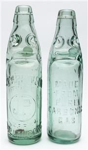Sale 9054E - Lot 14 - A J Parkinson (Wollongong) glass codd neck bottle with marble. Height 25cm together with an unbranded example bearing the message ...