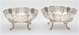 Sale 9085S - Lot 8 - Pair of George V Sterling Silver baskets, hallmarked Birmingham 1915, Hardy Bros, of shaped form, with pierced sides raised on four...