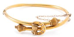Sale 9128J - Lot 18 - AN ANTIQUE GOLD DIAMOND SET OWL BANGLE; 3mm round 18ct hollow hinged bangle, bypass design with mitre style finials applied with an...