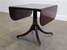 Sale 9196 - Lot 1041 - George III Style Mahogany Drop-Leaf Table, forming a rectangular top with rounded corners, on gun barrel pedestal with four outswept...