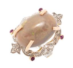 Sale 9221 - Lot 326 - A SILVER OPAL DIAMOND AND RUBY RING; claw set with a 21.64 x 15.05 x 11.73mm oval solid Ethiopian opal above scrolling surround with...
