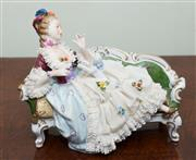 Sale 8368A - Lot 18 - An Unterweissbach reclining lady with puppy, L 35cm
