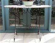 Sale 8866H - Lot 6 - An antique French style oval top patio table, Height 78cm, Length 110cm, Depth 70cm
