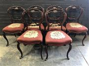 Sale 9031 - Lot 1073 - Set of Six Victorian Walnut Salon Chairs, with finely carved balloon backs, red floral tapestry seats & cabriole legs (H:86 W:44 D:4...