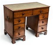 Sale 9015J - Lot 144 - An antique English mahogany 8 drawer double pedestal desk C: 1860. The green tooled leather top on a pair of freize drawers with...