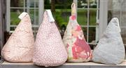 Sale 9060H - Lot 71 - A group of four fabric pyramid form door stops in pinks. H26cm