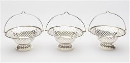 Sale 9085S - Lot 9 - Three George V Sterling Silver bon-bon baskets, hallmarked, Birmingham 1918, C.S.C & Co, with loop handle above a pierced checkered...