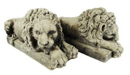 Sale 9150J - Lot 60 - A pair of cast stone recumbent opposite lion figures. Each 29cm x 10cm x 14cm