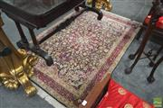 Sale 8255 - Lot 1006 - Small Chinese Silk Carpet, with rosette & arabesques on a navy field (190 x 120cm)