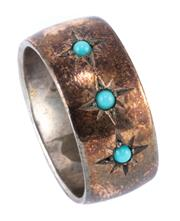 Sale 8974 - Lot 317 - A VINTAGE SCANDANAVIAN SILVER STONE SET RING; with 9ct gold overlay star set with 3 cabochon turquoise, width 8.94mm, size O.