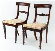 Sale 9015J - Lot 140 - A set of 8 antique George III Regency rosewood chairs C: 1825. The curved top rails on curved supports joined by a lower carved rail...