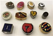 Sale 8436A - Lot 84 - A group of eleven assorted enamel topped pill boxes