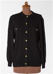 Sale 8550F - Lot 218 - A pair of cardigans; including a black St. John wool blend with gilt motif buttons and breast pockets, size M, together with a Scott...
