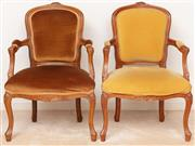 Sale 8926K - Lot 61 - A pair of Louis 15th style armchairs in gold velvet upholstery