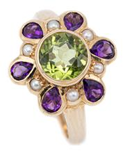 Sale 9083 - Lot 445 - A 9CT GOLD SUFFRAGETTE INSPIRED GEMSET RING; centring an approx. 1.50ct round cut peridot surrounded by seed pearls and pear cut ame...