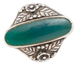 Sale 9128J - Lot 46 - A SILVER CHRYSOPRASE RING; centring an oval chrysoprase plaque 25 x 8mm to shoulders applied with flowers and leaves on tapering ban...