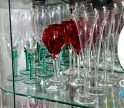Sale 8098A - Lot 102 - Coloured Stemware inc. Six Green Stemmed Champagne Flutes, Five Red Hock Glasses And Four Clear Trumpets