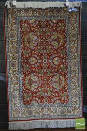 Sale 8255 - Lot 1073 - Small Chinese Silk Carpet, with scythe shaped leaves and boteh on a red ground (127 x 82cm)