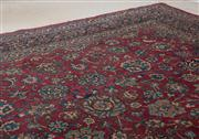 Sale 8595A - Lot 12 - Vintage Persian wool carpet, with arabesques of lotus flowers, on an indigo ground, 334 x 252cm, some faults and repairs