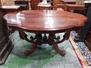 Sale 8774 - Lot 1030 - Good Victorian Rosewood Centre Table, with serpentine shaped top, on four swept supports joined in the centre with finial & sweeping...