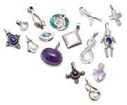 Sale 8974 - Lot 316 - FIFTEEN SILVER STONE SET PENDANTS; assorted shapes and sizes set with amethyst, cultured pearls, paua shell, mother of pearl, blue t...