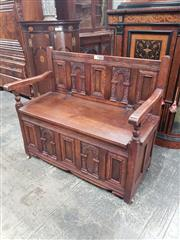 Sale 9031 - Lot 1029 - 17th Century Style Carved Oak Hall Seat, with panelled & arcaded back, hinged seat & conforming panels to base
