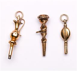 Sale 9119 - Lot 112 - A group of three Victorian 9ct and rolled-gold pocket watch keys