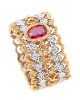 Sale 9177 - Lot 367 - AN 18CT TWO TONE GOLD RUBY AND DIAMOND BELOVED RING; 10.3mm wide pierced band front collet set with an oval cut ruby of approx. 0.40...