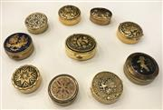 Sale 8436A - Lot 12 - A group of ten damascened lidded pill boxes of circular and oval form.